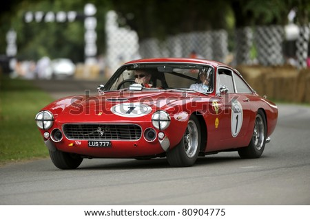 GOODWOOD, UNITED KINGDOM - JULY 3: A classic Ferrari drives up the hill at the Goodwood Festival of Speed in the United Kingdom on July 3rd 2011 in Goodwood, UK - stock photo