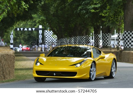 GOODWOOD, UNITED KINGDOM - JULY 3: Ferrari 458 drives up the hill at the Goodwood Festival of Speed in the United Kingdom on July 3, 2010 in Goodwood, UK - stock photo