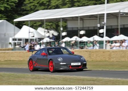 GOODWOOD, UNITED KINGDOM - JULY 3: Porsche GT3 RS drives up the hill at the Goodwood Festival of Speed in the United Kingdom on July 3, 2010 in Goodwood, UK - stock photo