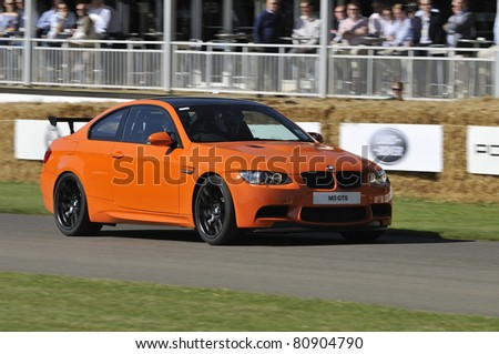 GOODWOOD, UNITED KINGDOM - JULY 3: The BMW M3 GTS drives up the hill at the Goodwood Festival of Speed in the United Kingdom on July 3rd 2011 in Goodwood, UK - stock photo
