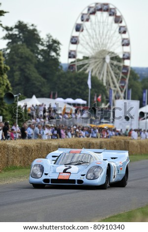 GOODWOOD, UNITED KINGDOM - JULY 1: The most Iconic Porsche 917 drives up the hill at the Goodwood Festival of Speed in the United Kingdom on July 1, 2011 in Goodwood, UK - stock photo