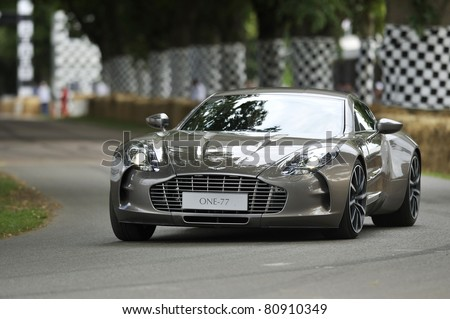 GOODWOOD, UNITED KINGDOM - JULY 1: The new and exclusive Aston Martin One-77 drives up the hill at the Goodwood Festival of Speed in the United Kingdom on July 1, 2011 in Goodwood, UK - stock photo