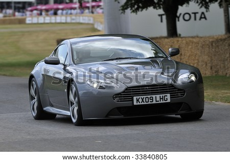 GOODWOOD, UNITED KINGDOM - JULY 3: The new Aston Martin V12 Vantage drives up the hill at the Goodwood Festival of Speed in the United Kingdom on July 3rd 2009 - stock photo