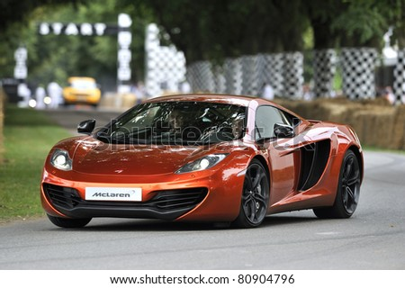 GOODWOOD, UNITED KINGDOM - JULY 3: The new McLaren MP4-12C drives up the hill at the Goodwood Festival of Speed in the United Kingdom on July 3rd 2011 in Goodwood, UK - stock photo