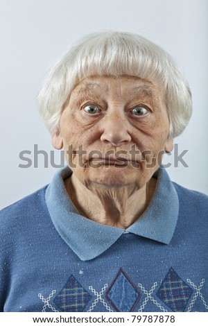 Goofy senior woman head and shoulders portrait - stock photo