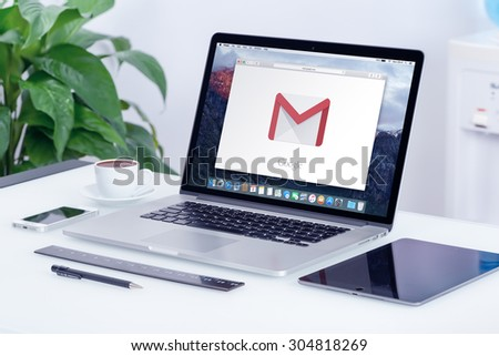 Google Gmail logo on the Apple MacBook Pro display that is on office desk in modern office work place. Gmail is a free e-mail service provided by Google. Varna, Bulgaria - May 29, 2015. - stock photo