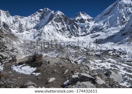 GORAKSHEP, NEPAL - CIRCA OCTOBER 2013: view of the Himalayas (Lingtren, Khumbutse) out of the way to Everest Base Camp  circa October 2013 in Gorakshep - stock photo