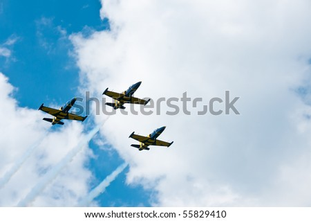 GORASZKA, POLAND - JUNE 13: Baltic Bees Jet Team flies in formation over Goraszka airfield during 15th International Air Picnic on June 13, 2010 in Goraszka, Poland