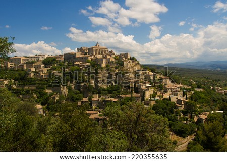 Gordes on the hill with blue skye, Provence, France - stock photo