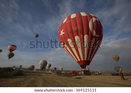 GOREME, CAPPADOCIA, TURKEY - February 14, 2015: Cappadocia, Turkey.The greatest tourist attraction of Cappadocia, the flight with the hot air balloons over the valley in Goreme