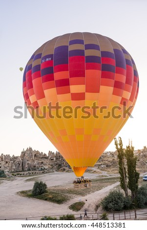 GOREME, CAPPADOCIA/TURKEY, JUNE 20TH: Image of You Go Travel Hot Air Balloon flying over Goreme located in Cappadocia, Kapadokya on 20th June, 2016 in Goreme