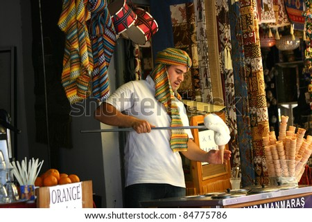 GOREME, TURKEY-AUGUST 8: Unidentified man makes Turkish dondurma for sale at a market on August 8, 2011 in Goreme, Turkey. Dondurma is a chewy, sticky ice cream made from the root of a wild orchid - stock photo