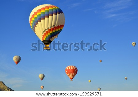 GOREME, TURKEY - OCTOBER, 02: Hot air balloon fly over Cappadocia is known around the world as one of the best places to fly with hot air balloons on october 02, 2013 in Goreme, Cappadocia, Turkey.