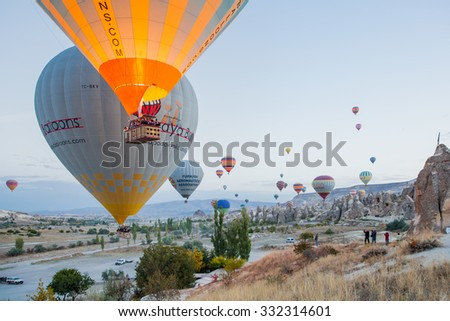 GOREME,TURKEY - OCTOBER 19, 2015: Hot air balloons fly over Cappadocia is known around the world as one of the best places to fly with hot air balloons,