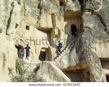 Goreme, Turkey, sep 7, 2011: Volcanic cliffs and rock formations at Cappadocia, Anatolia, Turkey - stock photo