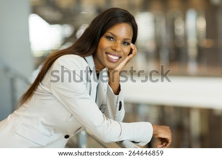 gorgeous afro american career woman looking at the camera - stock photo