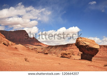 "Gorgeous American Red Desert. A huge ""mushroom"" out of red sandstone. Solar hot afternoon"