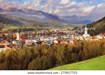 Gorgeous Austria. The picturesque small town is wonderfully illuminated by the sun.  Mountain valley in the Alps - stock photo
