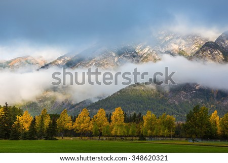 Gorgeous autumn in the Rocky Mountains. Golf courses in Banff - stock photo