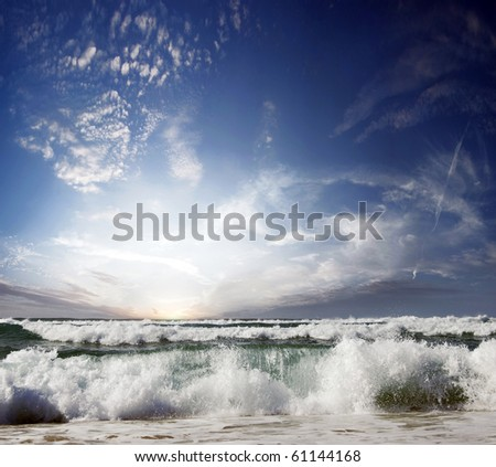 Gorgeous Beach in Summertime, Storm clouds with sun over sea