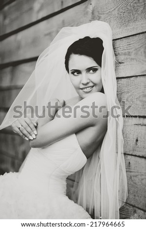 Gorgeous beautiful brunette  bride in white dress. - stock photo