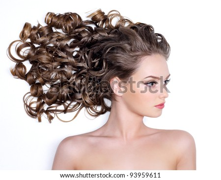 Gorgeous beautiful long curly hair of young woman - white background
