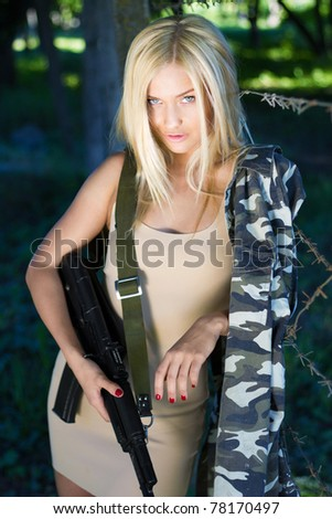 Gorgeous blond is fond of military style - stock photo