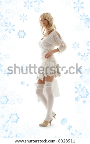 gorgeous blond with shopping bag and snowflakes - stock photo