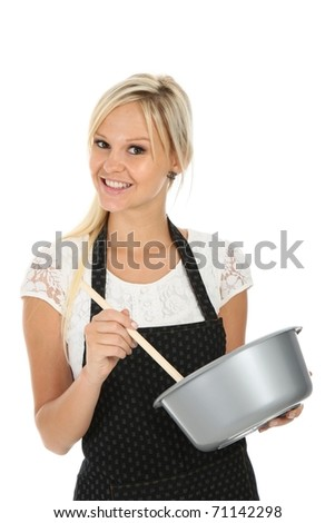 Gorgeous blond woman in apron with cooking bowl and spoon
