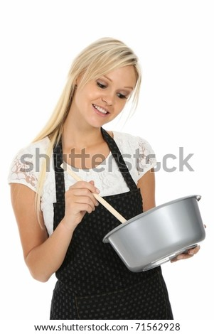 Gorgeous blond woman in apron with cooking bowl and spoon - stock photo
