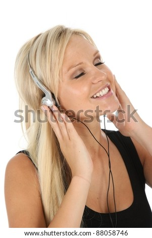 Gorgeous blond woman listening to music on earphones - stock photo