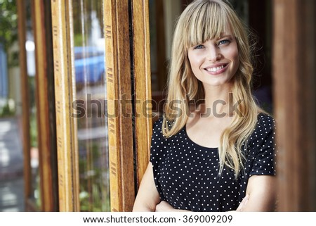 Gorgeous blond woman smiling for camera