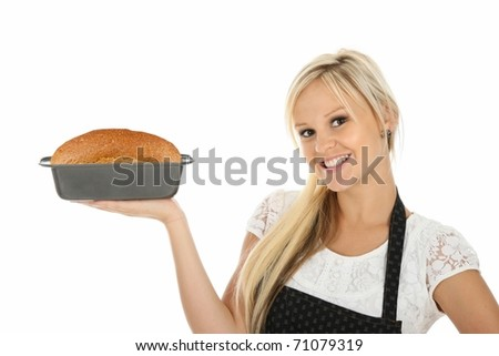 Gorgeous blond woman with home baked loaf of bread - stock photo
