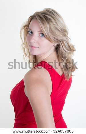 Gorgeous blond young woman with an elegant red dress