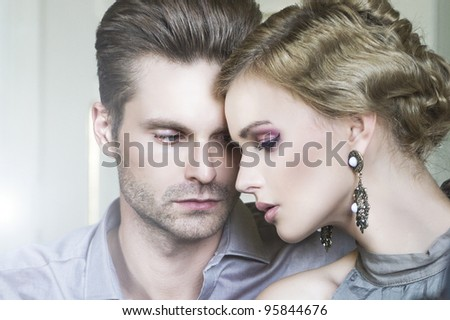 Gorgeous blonde and handsome man - stock photo