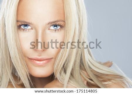 Gorgeous blonde female with blue eyes. studio beauty shot. horizontal - stock photo