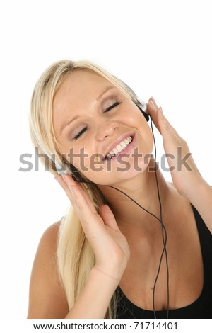 Gorgeous blonde girl listening to music on her earphones - stock photo