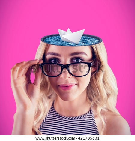 Gorgeous blonde hipster posing with glasses against pink background - stock photo