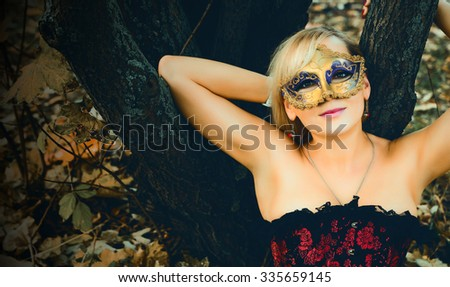 gorgeous blonde with carnival mask - stock photo
