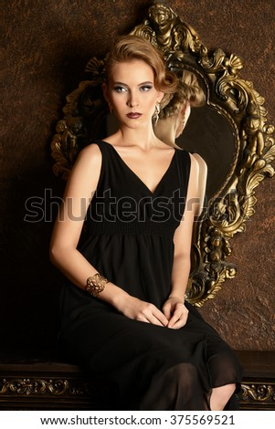 Gorgeous blonde woman in a luxurious classic interior. Beauty, fashion.