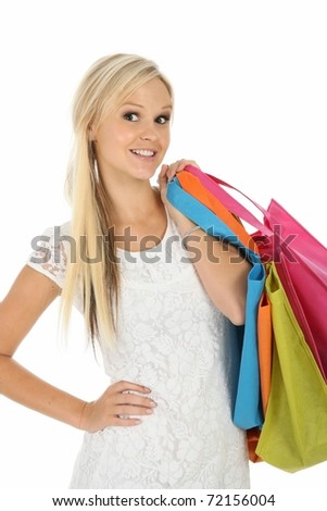 Gorgeous blonde woman with colorful shopping bags - stock photo