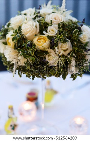 Gorgeous bouquet of white roses and greenery