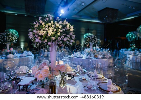 Wedding decoration stock images royalty free images vectors wedding hall gorgeous bouquets of white roses stand on the dinner tables junglespirit Gallery