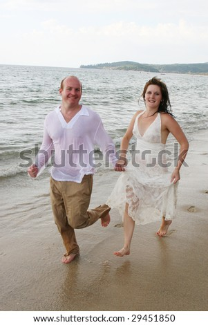 Gorgeous bride and groom on the beach - tropical destination wedding.