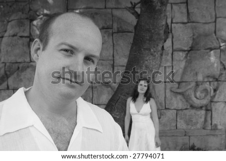 Gorgeous bride and groom on their wedding day - black and white.