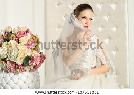 Gorgeous bride in a white elegant room