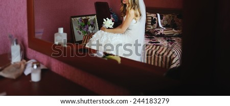 Gorgeous bride in hotel in the morning. - stock photo