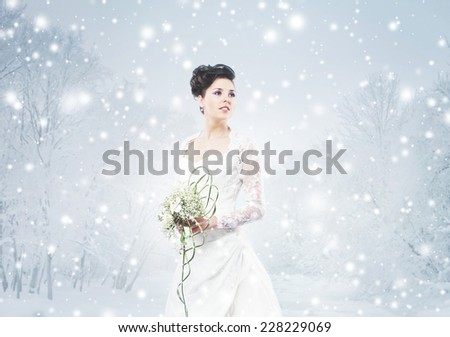 Gorgeous bride in wedding dress over the Christmas background - stock photo