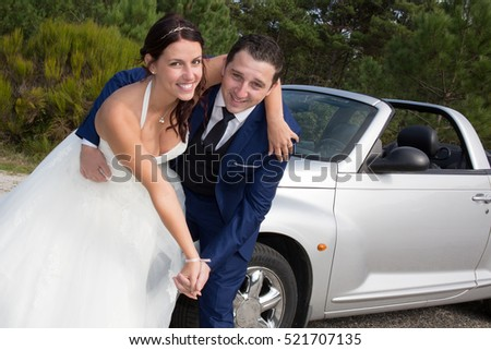 Gorgeous bride near a luxury wedding dress with handsome groom