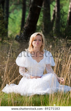 gorgeous bride posing in forest - stock photo